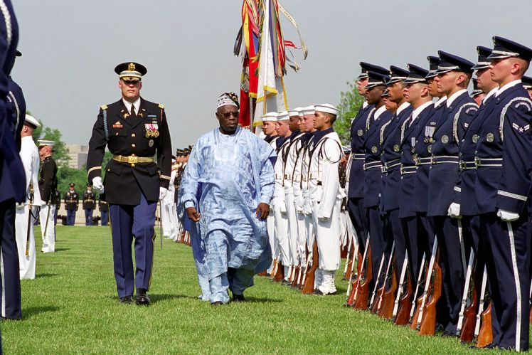 Picture: Olusegun Obasanjo participates in a Full Honor Arrival Ceremony hosted by the Honorable Donald H. Rumsfeld (not pictured), U.S. Secretary of Defense, at the River Entrance of the Pentagon, Arlington, VA, May 10, 2001. Credit: Helene C. Stikkel