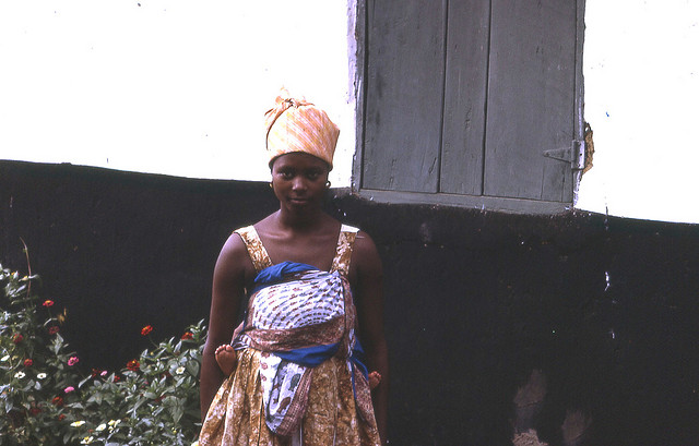 Photo: Young woman with baby on back. Credit: John Atherton, 1968
