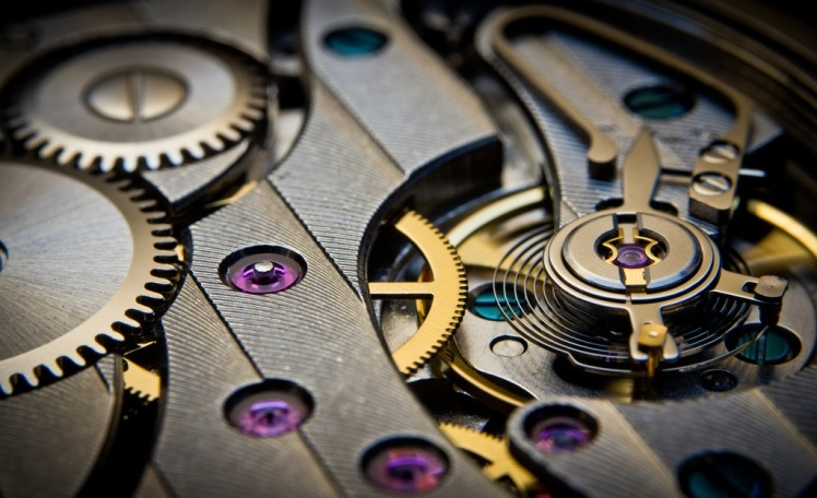 Photo: the wheel/gear chain in a mechanical watch. Credit: Guy Sie