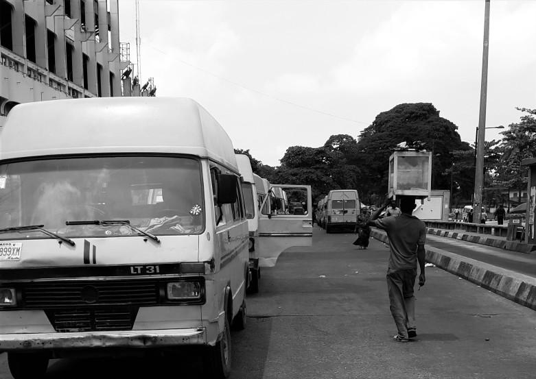 A hawker selling puff puff near Lagos' Tafawa Balewa Square. Photo Credit: Eniola Anuoluwapo Soyemi