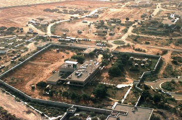 Aerial view of the left side of the US Embassy compound in Mogadishu, Somalia.  The Joint Task Force Headquarters for Restore Hope is located there.  There are plans to build a tent city on the compound.  Several tents and United Nations equipment are located outside the walls of the embassy at the top of the frame.  This mission is in direct support of Operation Restore Hope.